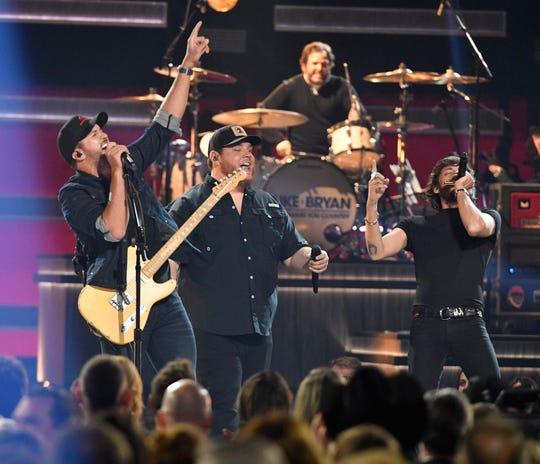 Luke Bryan, Luke Combs and Chris Janson perform during the 52nd Annual CMA Awards at Bridgestone Arena Wednesday Nov. 14, 2018, in Nashville, Tenn.