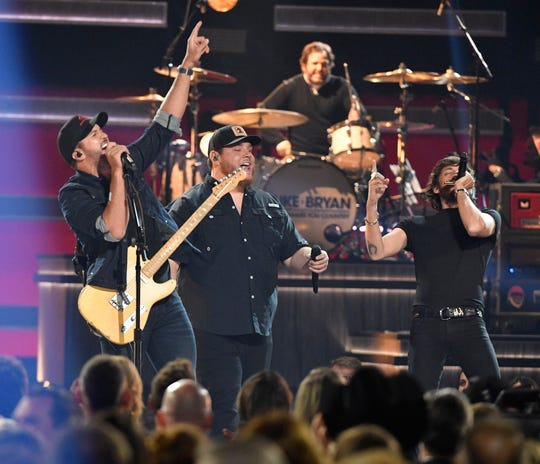 Luke Bryan, Luke Combs and Chris Janson perform during the 52nd Annual CMA Awards at Bridgestone Arena Wednesday Nov. 14, 2018, in Nashville, Tenn.