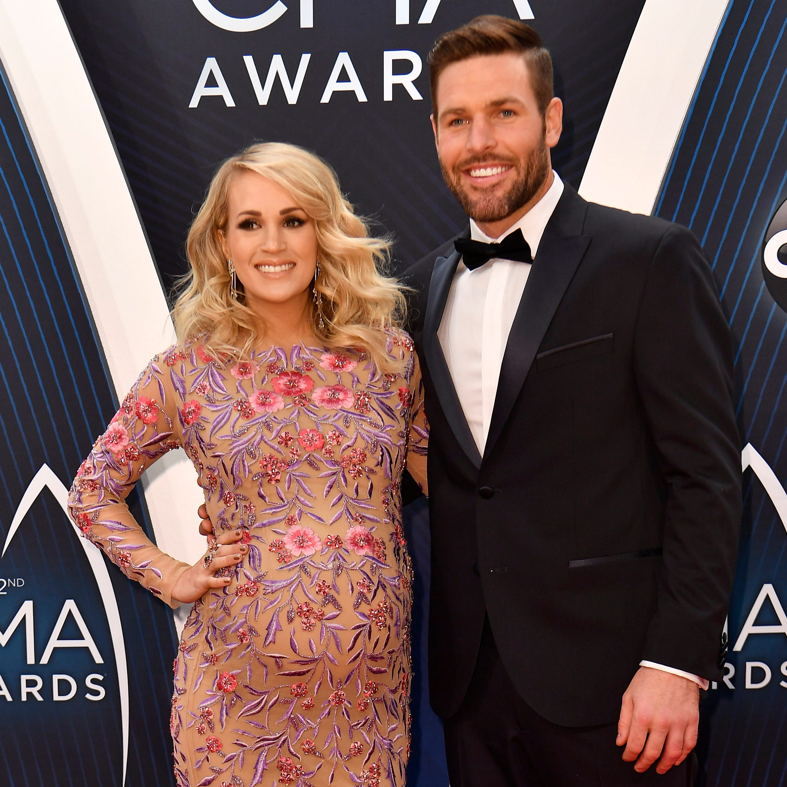 Carrie Underwood and husband Mike Fisher on the red carpet before the 52nd Annual CMA Awards at Bridgestone Arena Wednesday, Nov. 14, 2018, in Nashville, Tenn.