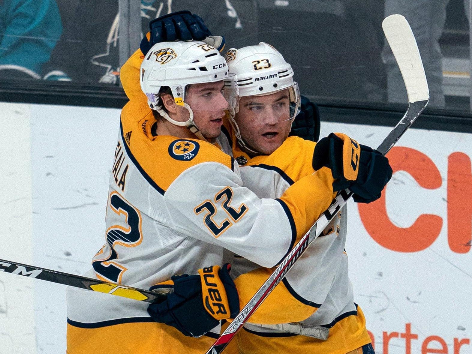 Nashville Predators left wing Kevin Fiala (22) and center Rocco Grimaldi (23) celebrate after a goal against the San Jose Sharks during the third period at SAP Center at San Jose.