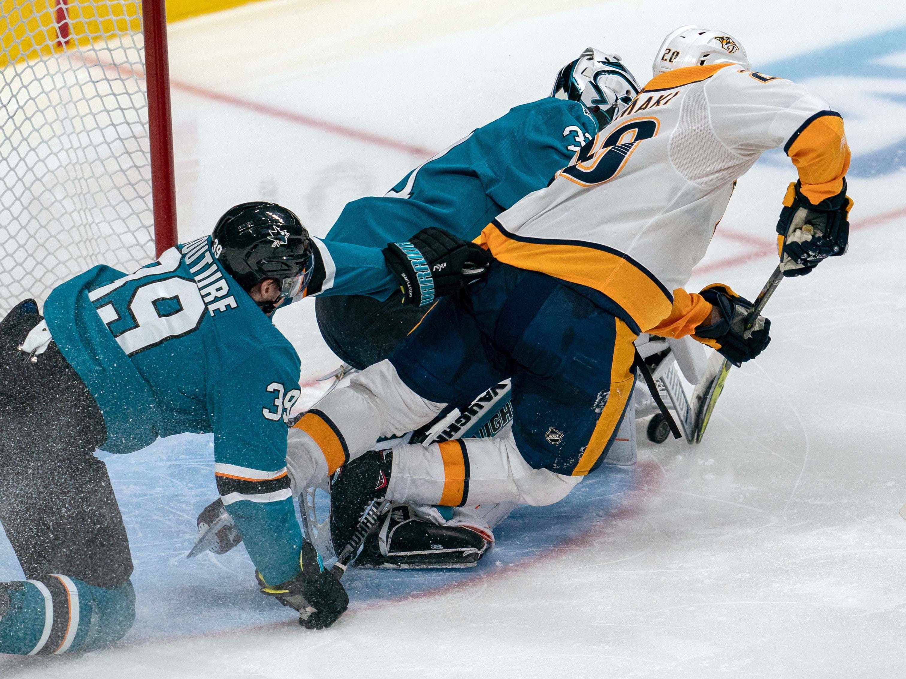 Nov 13: Sharks 5, Predators 4 -- Nashville Predators right wing Miikka Salomaki (20) shot is blocked by San Jose Sharks goaltender Martin Jones (31) during the third period at SAP Center at San Jose.