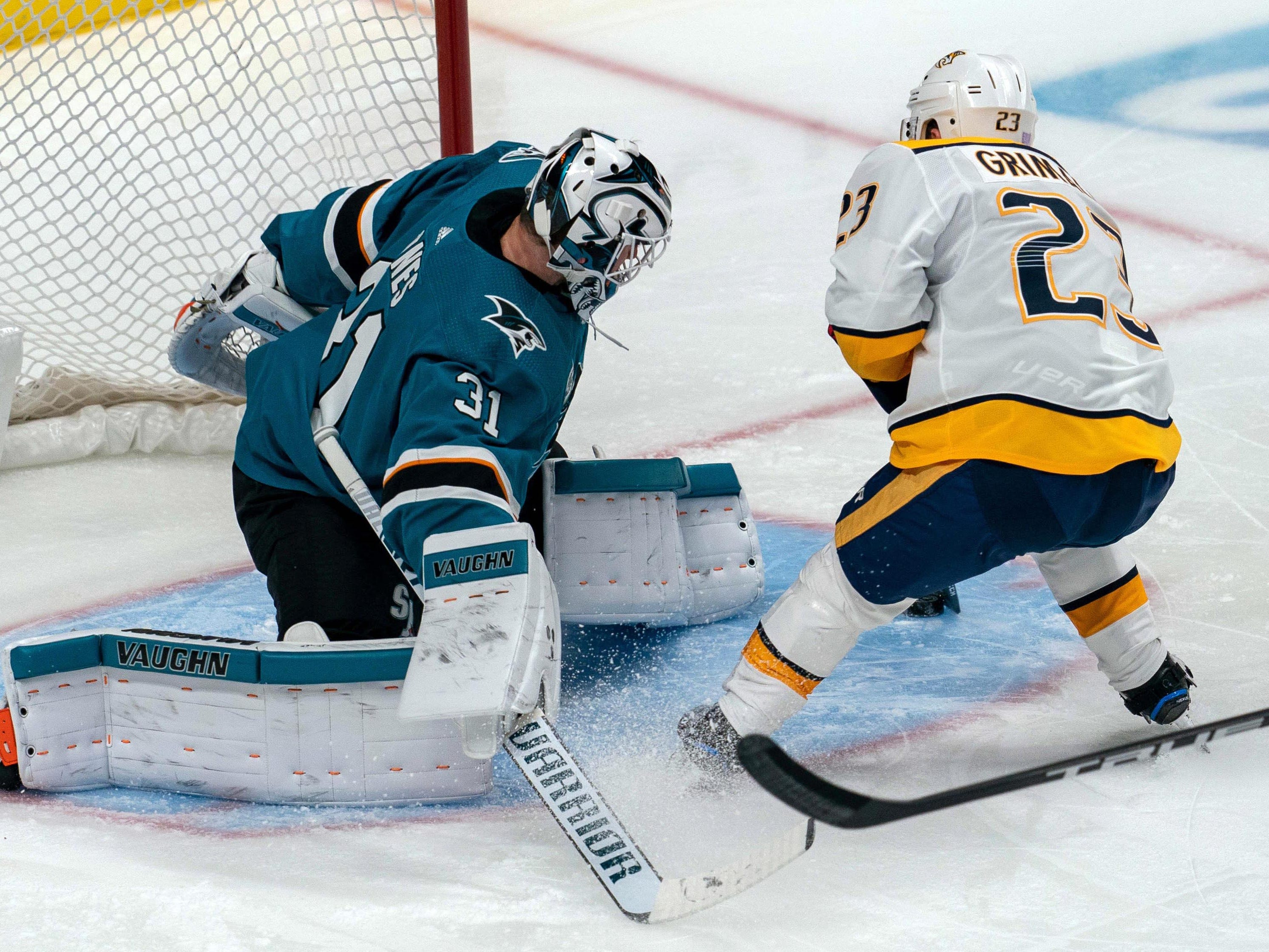 Nashville Predators center Rocco Grimaldi (23) jukes San Jose Sharks goaltender Martin Jones (31) during the third period to score during the third period at SAP Center at San Jose.