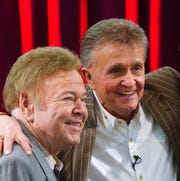 "Roy Clark, left, and Bill Anderson spend time on the set of the ""Country's Family Reunion"" salute to ""Hee Haw."" As a solo artist, Clark's breakout came in 1963 when his version of Anderson's ""Tips of My Fingers"" hit No. 10 on the country charts."