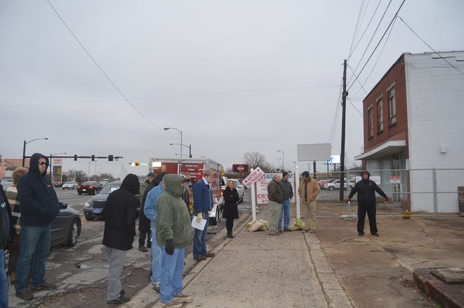 A crowd suffers through cold weather for the absolute auction of the historic Randy's Record Shop building in Gallatin.