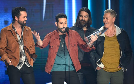 Old Dominion accepts the award for Vocal Group of the Year during the 52nd Annual CMA Awards at Bridgestone Arena Wednesday Nov. 14, 2018, in Nashville, Tenn.
