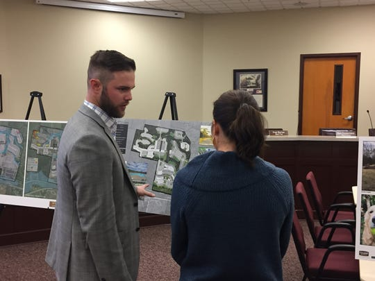 Wayne Miller, left, of Goodall Homes, speaks with incoming Lebanon Councilwoman Jeni Lind Brinkman, right, at a presentation for a proposed housing development named Stoney Farms on Nov. 14, 2018.