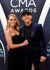 Granger Smith and wife Amber Bartlett on the red carpet before the 52nd Annual CMA Awards at Bridgestone Arena Wednesday, Nov. 14, 2018, in Nashville, Tenn.