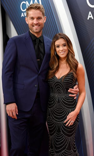 Newlyweds Brett Young and Taylor Mills on the red carpet before the 52nd Annual CMA Awards at Bridgestone Arena Wednesday, Nov. 14, 2018, in Nashville, Tenn.
