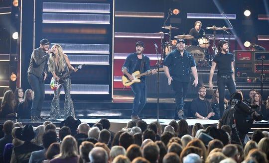 Luke Bryan performs with Cole Swindell, Lindsay Ell, Luke Combs and Chris Janson during the 52nd Annual CMA Awards at Bridgestone Arena Wednesday Nov. 14, 2018, in Nashville, Tenn.
