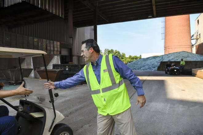 President and CEO Donald Michelotti of Carlex Glass Company greets people as they drive through the plant, in Nashville, Tenn., Tuesday, July 25, 2017.