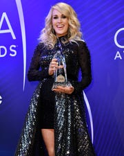 Carrie Underwood holds her Female Vocalist of the Year Award during the 52nd Annual CMA Awards at Bridgestone Arena Wednesday, Nov. 14, 2018, in Nashville, Tenn.