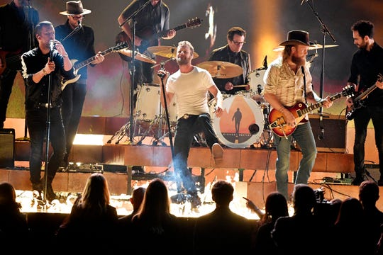 Dierks Bentley performs with the Brothers Osborne during the 52nd annual CMA Awards on Nov. 14, 2018, at Bridgestone Arena in Nashville.