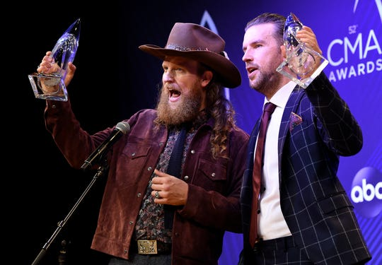 The Brothers Osborne celebrate their win for the Duo of the Year at the 52nd Annual CMA Awards at Bridgestone Arena Wednesday, Nov. 14, 2018, in Nashville, Tenn.
