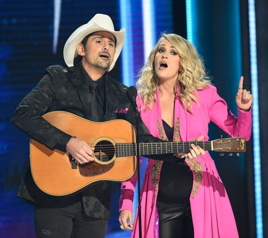 Hosts Brad Paisley and Carrie Underwood perform during their opening monologue during the 52nd Annual CMA Awards at Bridgestone Arena Wednesday Nov. 14, 2018, in Nashville, Tenn.