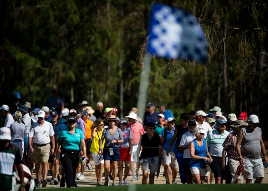 Crowds walk toward the green during the CME Group Tour Championship, the final event of the LPGA Tour, on Thursday at Tiburón Golf Club in Naples.