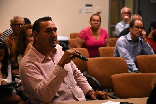 Property owner Luis Medina adds his viewpoint. County planners held a Neighborhood Information Meeting on Nov. 8 to share ideas about revitalizing the Golden Gate Parkway corridor.