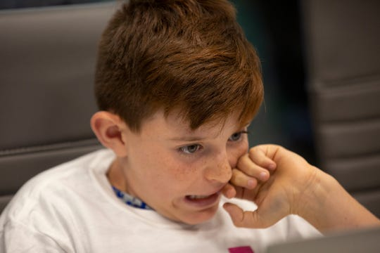 Levi Bourk works on his project during a coding class Wednesday, Nov. 14, 2018, at Logiscool in Naples.