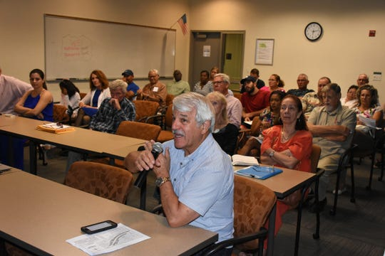Collier County Commissioner Burt Saunders speaks about the Golden Gate community. County planners held a Neighborhood Information Meeting on Nov. 8 to share ideas about revitalizing the Golden Gate Parkway corridor.