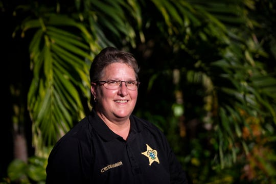 Lt. Leslie Weidenhammer, who works in the mental health bureau of the Collier County Sheriff's Office, poses for a portrait on Wednesday, Nov. 14, 2018, at NAMI of Collier County in Naples.