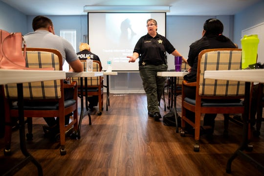 Lt. Leslie Weidenhammer, who works in the mental health bureau of the Collier County Sheriff's Office, leads a crisis intervention training on Wednesday, Nov. 14, 2018, at NAMI of Collier County in Naples.