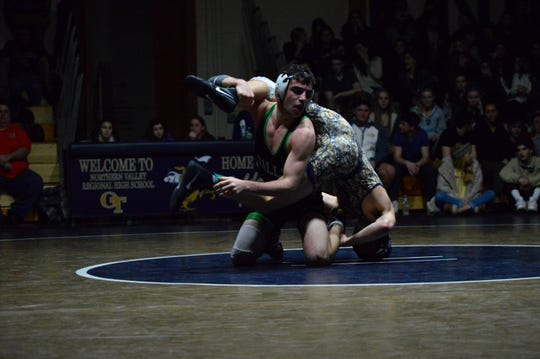 Pascack Valley wrestler Matt Beyer flips his opponent in a wrestling match at Northern Valley Old Tappan.