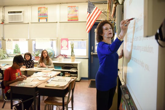 Fifth-grade teacher Yvonne Visocky began her 50th year teaching at Westmoreland Elementary School in Fair Lawn this year. Visocky reviews a math lesson with her class on Thursday, November 15, 2018.