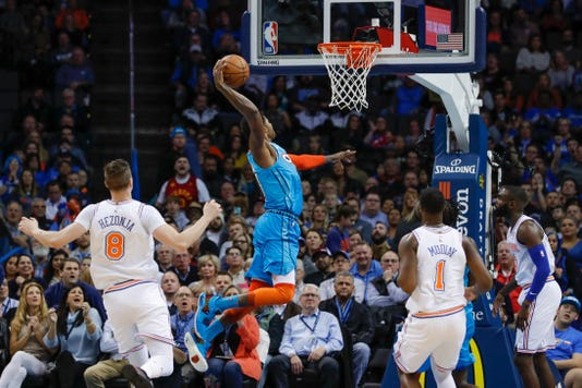 Oklahoma City Thunder forward Paul George (13) goes up to dunk against the New  York Knicks during the first half of an NBA basketball game in Oklahoma  City, ...