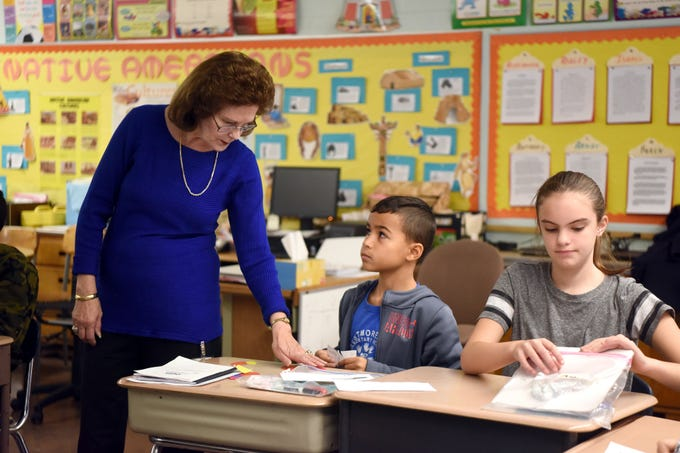 Fifth-grade teacher Yvonne Visocky began her 50th year teaching at Westmoreland Elementary School in Fair Lawn this year. Visocky reviews a math lesson with Darren on Thursday, November 15, 2018.