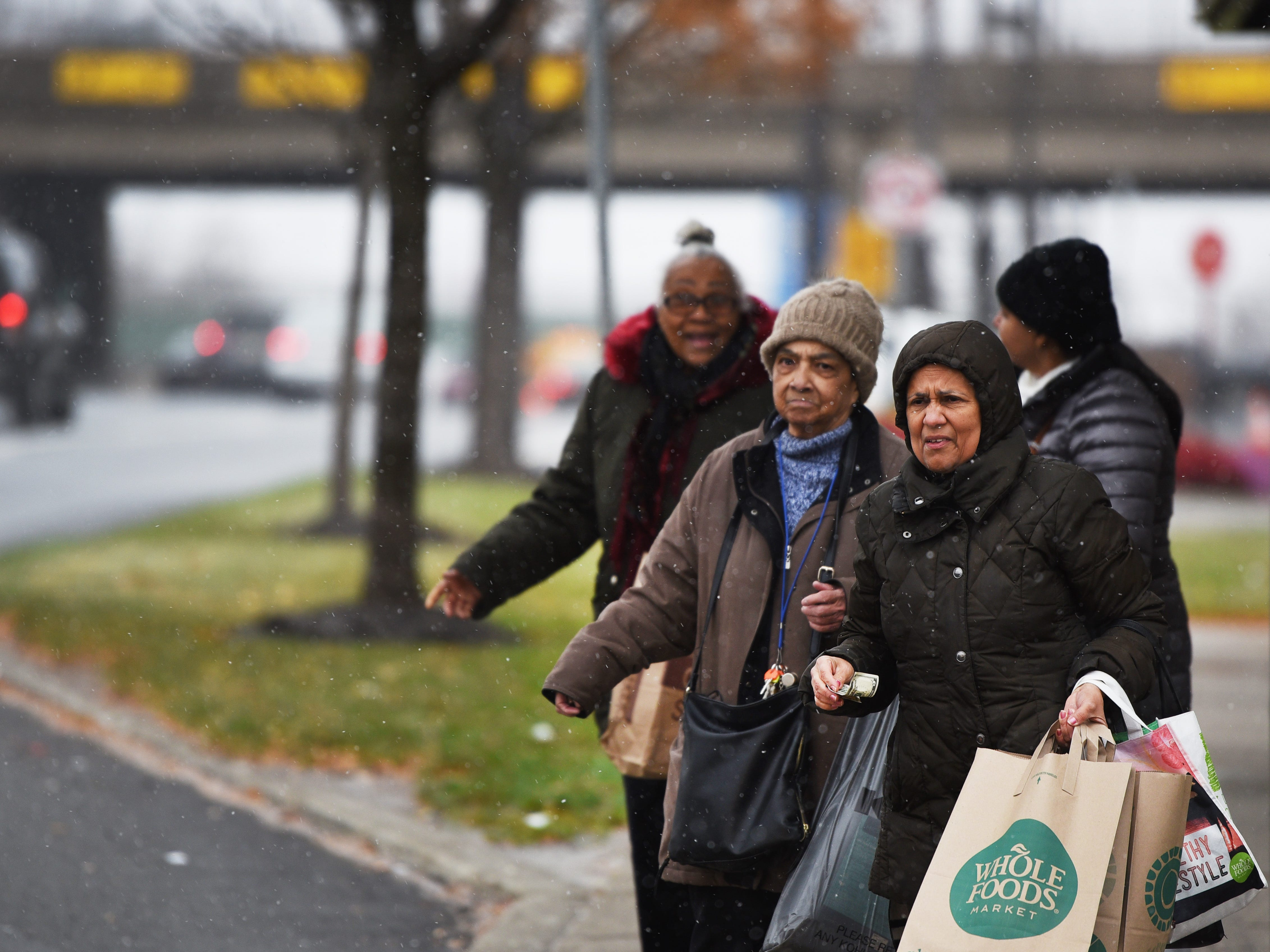 November 15, 2018, Paramus, NJ, USAShoppers wait at the stop along Route 4 East as the snow begins to fall at Bergen Town Center.