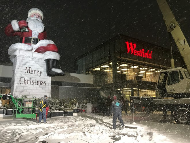 Big Santa was partially assembled at Garden State Plaza on Thursday, but the big reveal will have to wait due to snow.