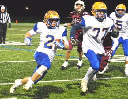 Lyndhurst senior guard Shane D'Andrea (77) leading the way for running back Piotr Partyla against the Verona defense.