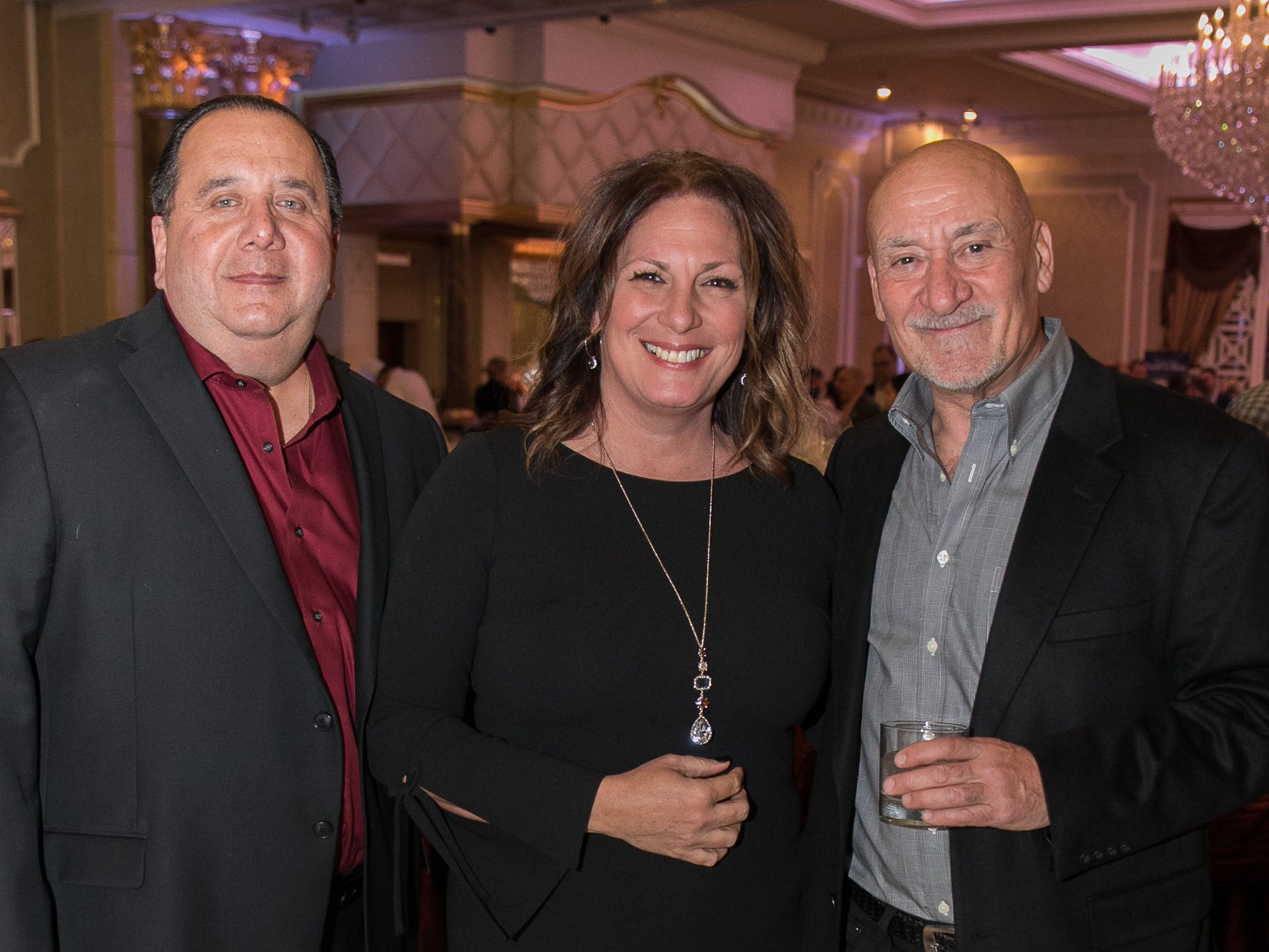 "Lenny and Debbie Fabiano, Tommy Eastwick. The New Bridge Medical Center Foundation held its 10th Annual ""A Taste of Bergen"" at The Venetian in Garfield. The evening featured celebrity chef Chris Holland, the 2017 Grand Champion of the Food Network's ""Chopped."" 11/12/2018"