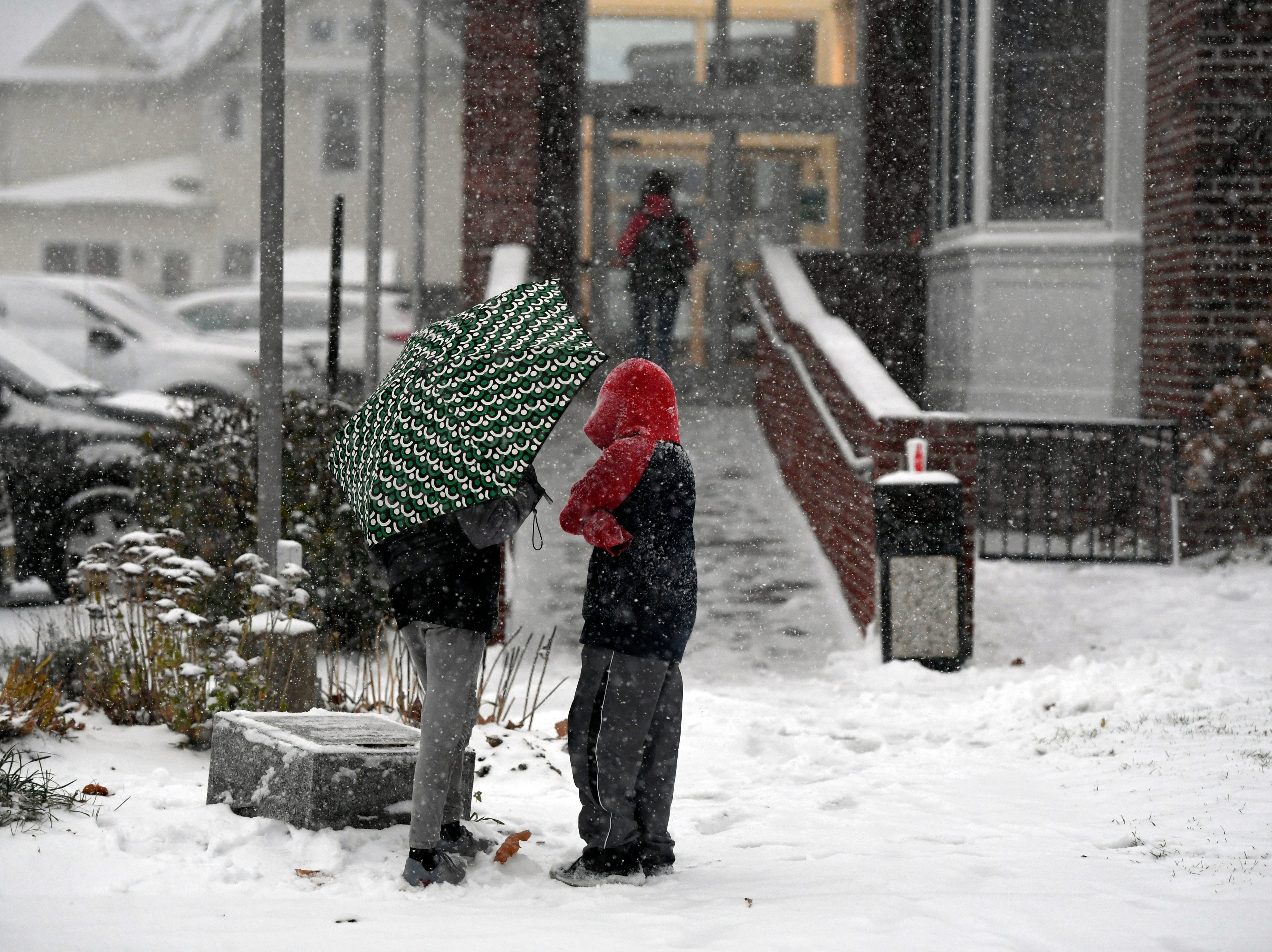 Two boys wait outside of the Westwood Public Library as the first snowfall of the year hits North Jersey on Thursday, Nov. 15, 2018, in Westwood.