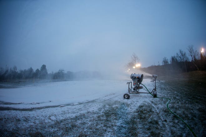 Snowmaking machines run in the evening of Nov. 14, 2018 at Mountain Creek in Vernon. The cold temperatures and pending snow storm allowed the resort to get a jump start of ski-season activities, resort staff said.