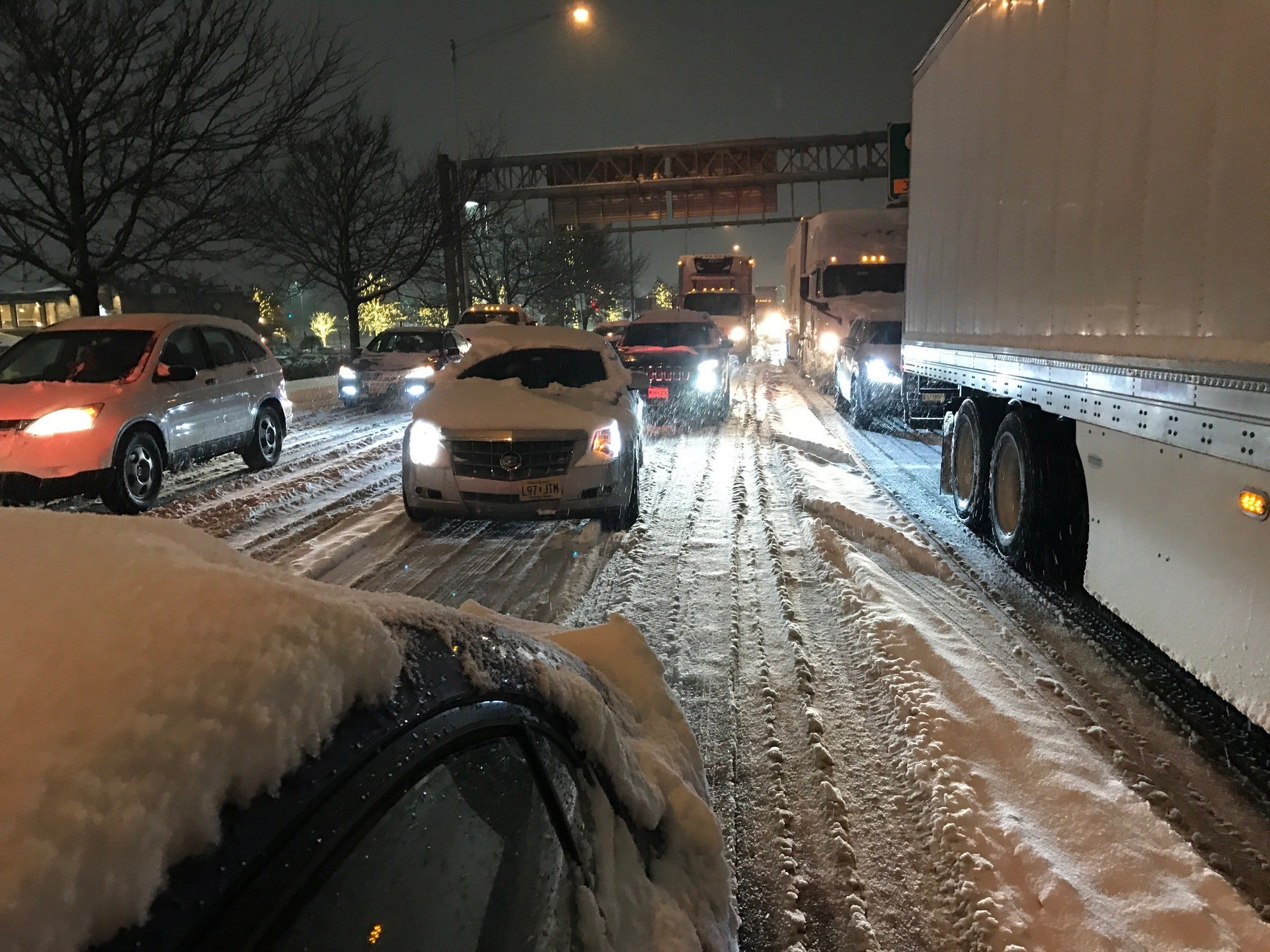 Commuters sit in heavy traffic on Route 17 South due to snow on Thursday, Nov. 15.