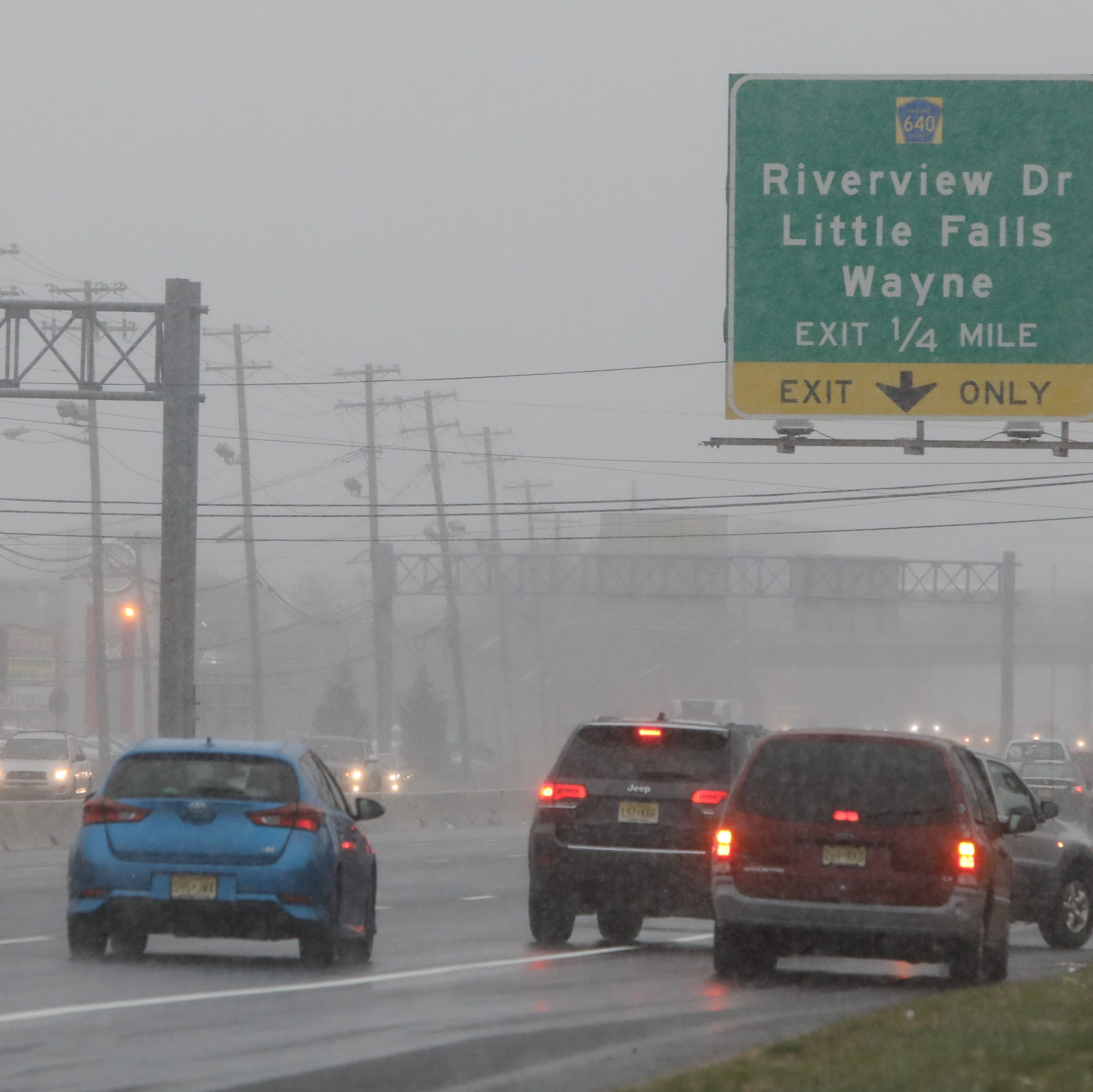 The snow starts falling as traffic moves along Route 46 facing west at 2pm.