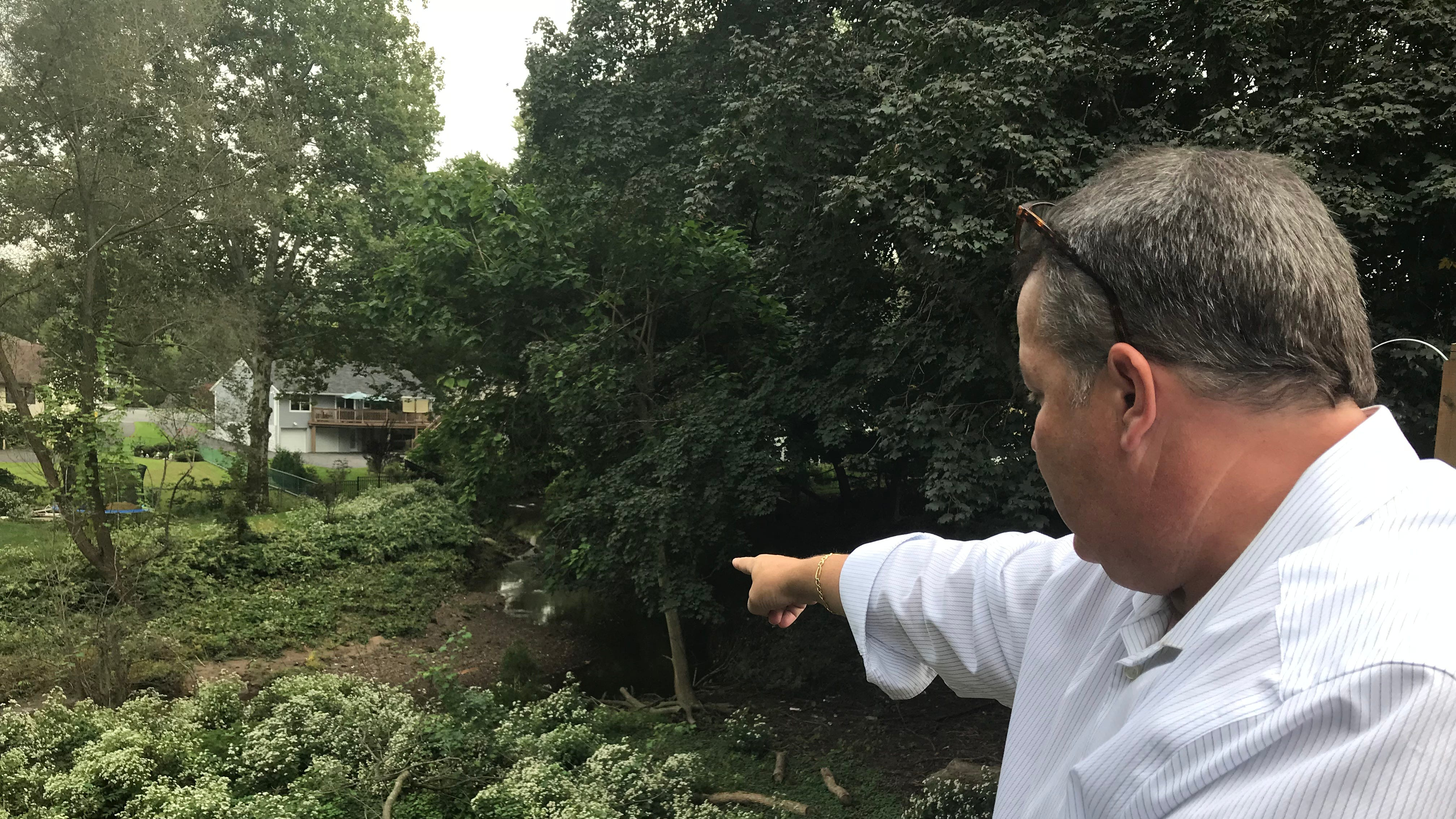 New Milford resident sees yard eroding, blames flood project