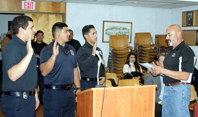 Three new firefighter/EMTs were sworn in at Monday's City Council Meeting at the John Strand Municipal Building. Deming Mayor Benny Jasso, at right, administered the oath to (from left) Christian Orozco, Eric Miller and Alejandro Diaz.