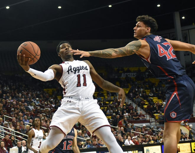 New Mexico State's Keyon Jones goes up for a layup against Saint Mary's on Wednesday night at the Pan American Center.