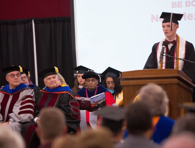 New Mexico State University President John Floros and Chancellor Dan Arvizu look on as student body president Emerson Morrow, right, speaks at their inauguration ceremony on Thursday, November 15, 2018.