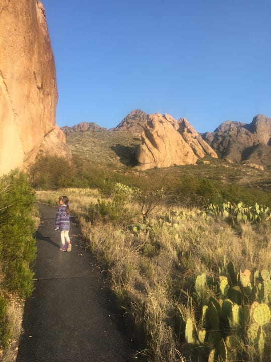 Freelance reporter Cassie McClure's 6-year-old daughter hikes the La Cueva trail, a roughly 1-mile trail to a cave hidden under the boulders.