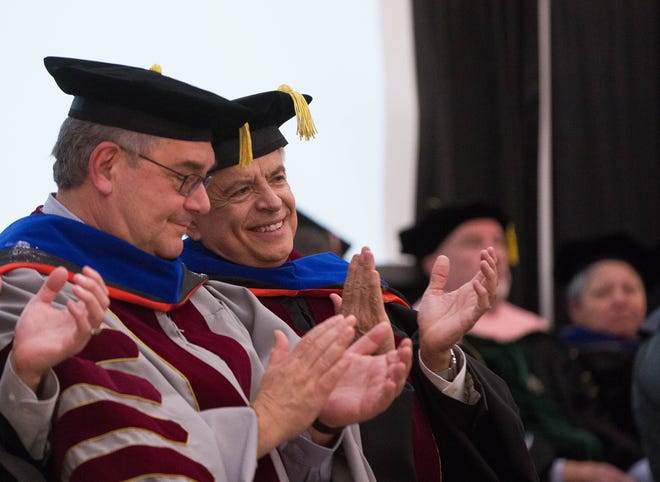 New Mexico State University President John Flores and Chancellor Dan Arvizu talk to one another between speakers during their inauguration, Thursday November 15, 2018.