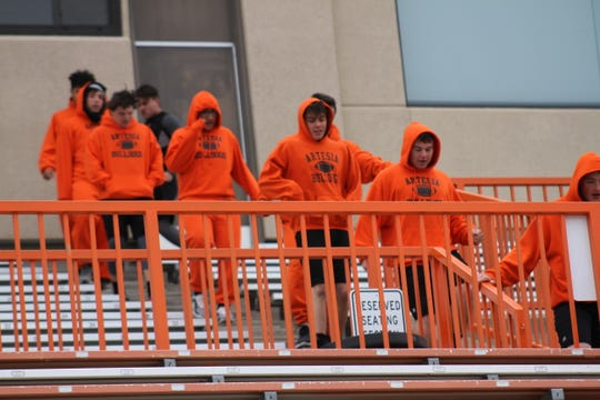 Artesia's offensive and defensive linemen run the stairs at the Bulldog Bowl during Monday's practice. Artesia hosts Piedra Vista in the 5A quarterfinals this Saturday.