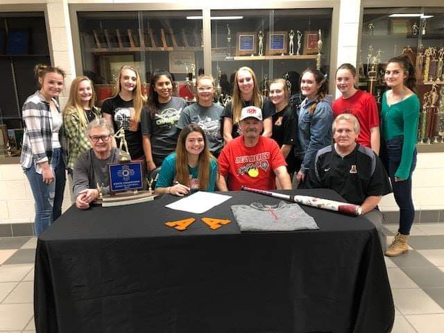 Aztec's Jocelyn Ulrich signs her letter of intent on Wednesday to continue her softball career at University of New Mexico.