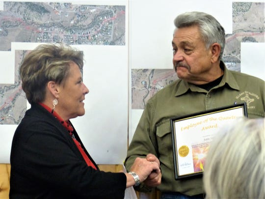Eddie Saenz with the Forestry Department was recognized with the Community Service Award by Village Manager Debi Lee.