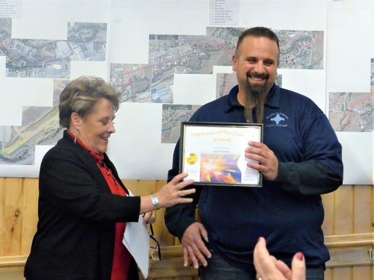 Village Manager Debi presents the Public Works Award to Adam Sanchez.