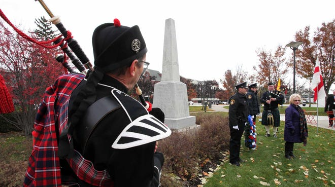 Bagpiper Randy Oleynik provides musical support during the DAR/City of Birmingham wreath-laying at the World War I monument.