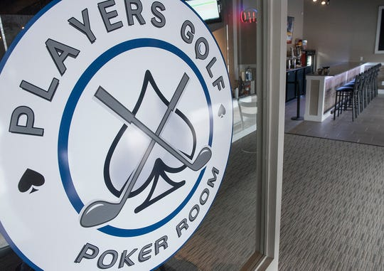 Players Golf and Poker Room is open in Livonia. At right is the bar area of the business.
