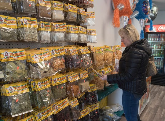Customer Sue Wood of Livonia often drives to markets in southwest Detroit. Now she has a local alternative in her hometown.