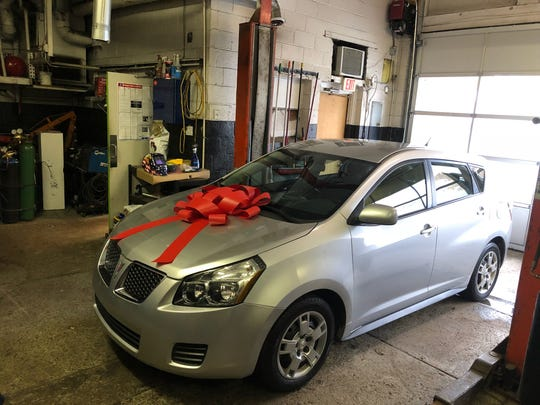 The 2009 Pontiac Vibe donated to a Milford woman thanks to efforts of local businesses.